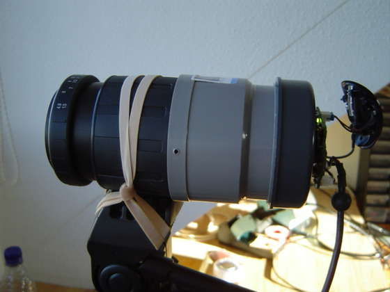 Now you can try it. Hook it up to a pc and put it on a tripod. Aim at something more than 50 meters away and see if you can focus by turning the focus ring of the tele lens. If you can't, then you must play with the distance between the tele lens and the webcam.