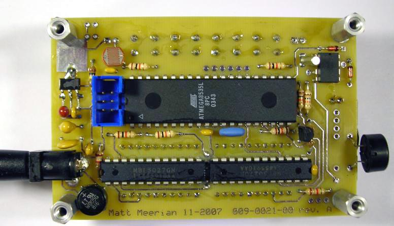 Blue Clock (Atmel Atmega8535 microcontroller). The top of the circuit board