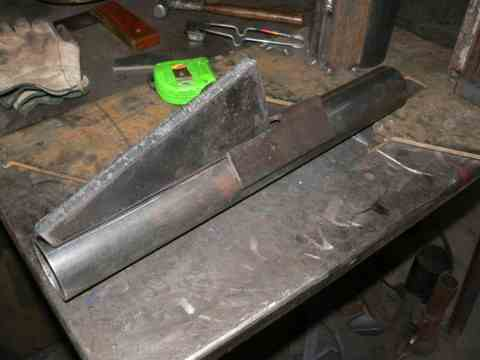 Pictured above is the previously mentioned tail bracket being setup for welding to the tail pivot.