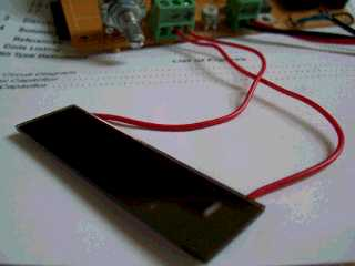 The righhand shows the input sensor made with a calculator solar cell.
