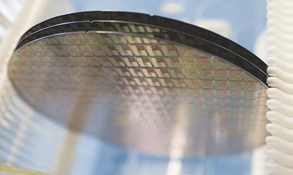 NXP chip wafers. Qualcomm has little experience manufacturing chips. It usually pays foundries to turn its blueprints into actual products, while licensing patents to companies eager to put its wireless chips into smartphones