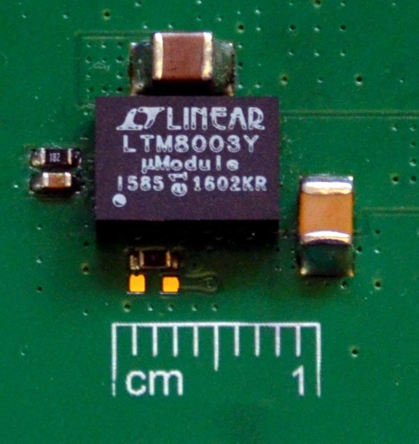A complete step-down solution is barely larger than the 6.25 mm × 9 mm footprint of the LTM8003 µModule regulator.