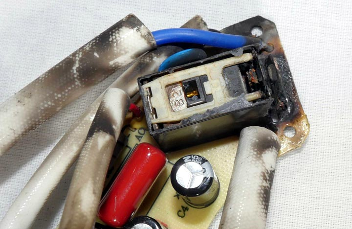 This relay burned up inside a Cuisinart tea kettle. The top is removed to view the internal damage, which was extensive. Non-hermetic relays can be a problem in wet environments.