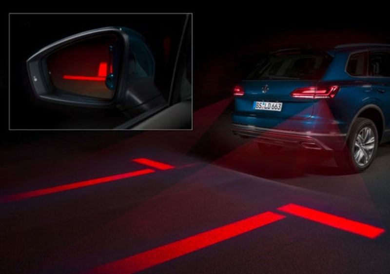 A pair of red warning lines projected onto the road when a car is reversing lets pedestrians know the danger zone.