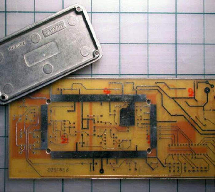 Simple technique makes low-cost pc-board shields