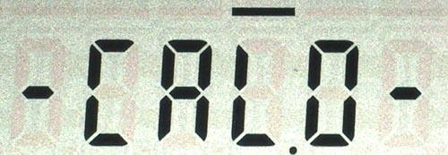 Калибровка нуля. (а) - индикация процесса калибровки, (б) - результат.