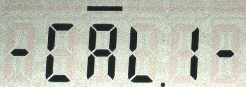 Калибровка полной шкалы. (а) - индикация процесса калибровки, (б) - результат.